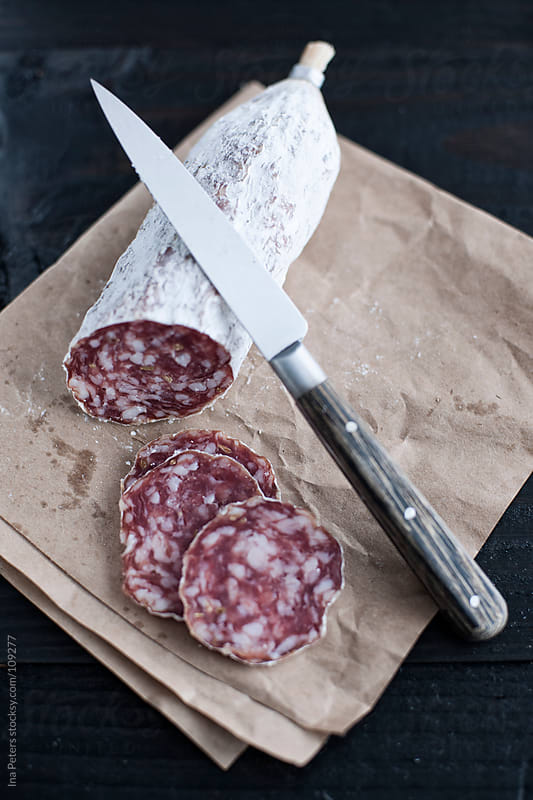 Food: Fennel Seed Salami and knife by Ina Peters for Stocksy United