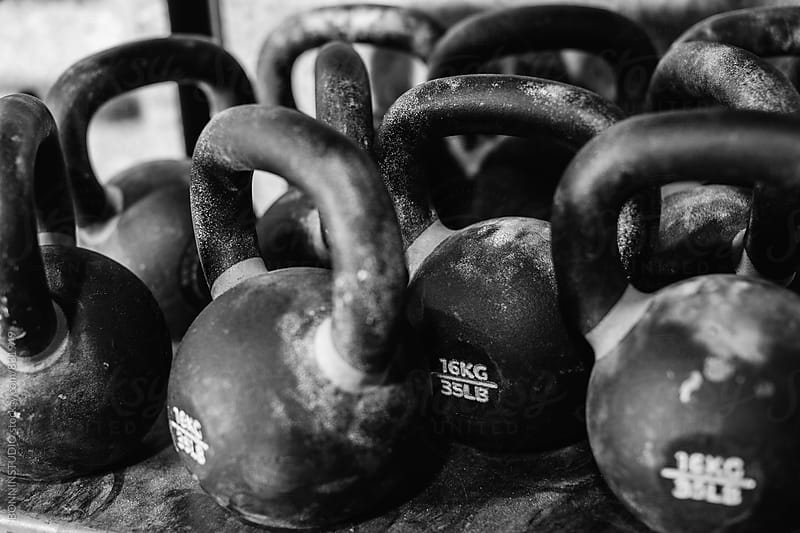 Kettlebells in a gym. Black and white photo. by BONNINSTUDIO for Stocksy United