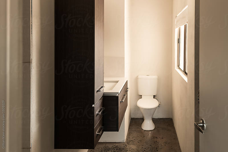 dormitary style accommodation, simple but small bathroom by Gillian Vann for Stocksy United