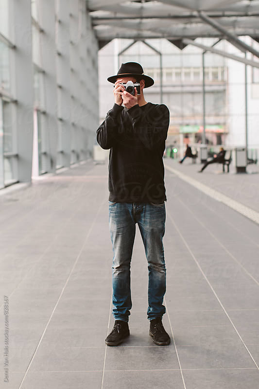 Creative man working with camera and taking photos by Denni Van Huis for Stocksy United