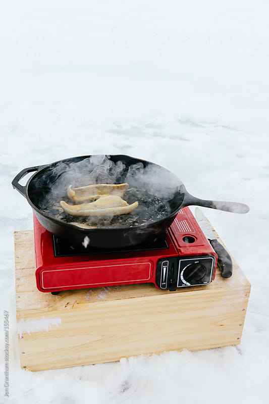 Cooking Outdoors by Jen Grantham for Stocksy United