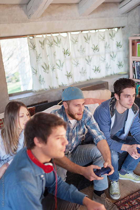 Flatmates Play with Video Game and Watching TV by HEX. for Stocksy United