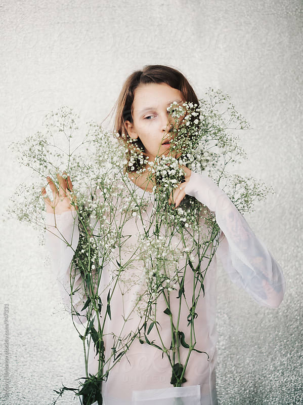 Spring portrait of a girl with flowers in studio by Sergey Filimonov for Stocksy United