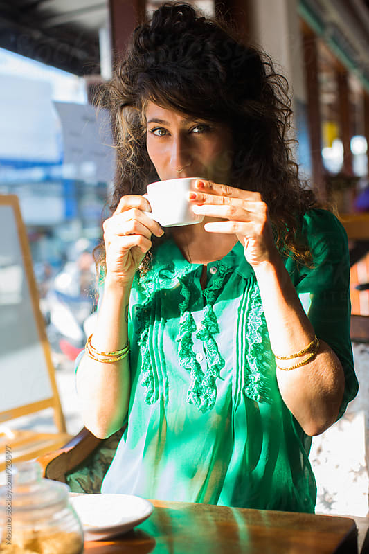 Woman Drinking Coffee in a Coffee Shop by Mosuno for Stocksy United