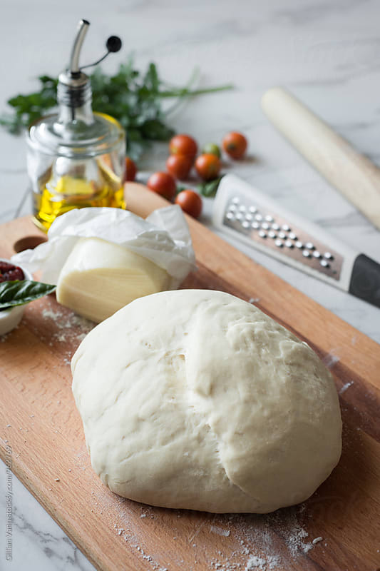pizza dough ready for pizza by Gillian Vann for Stocksy United