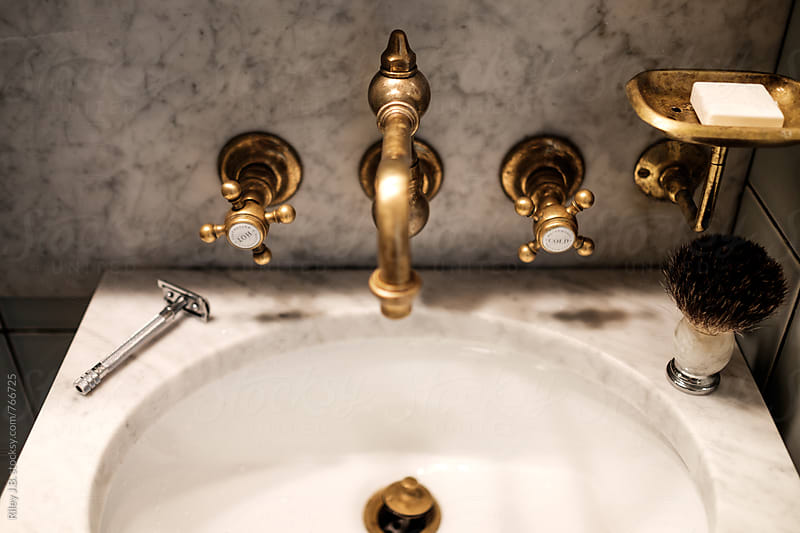 An antique sink with vintage razor & brush. by Riley J.B. for Stocksy United