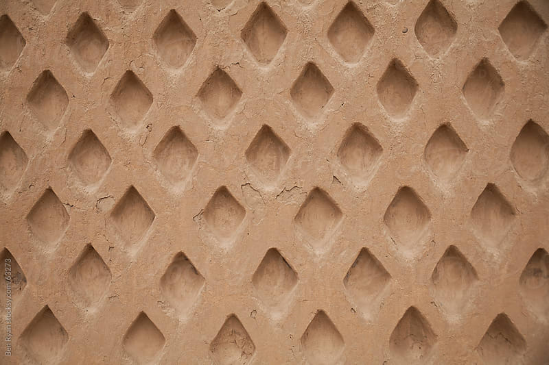 Lattice pattern background in adobe rendered wall by Ben Ryan for Stocksy United