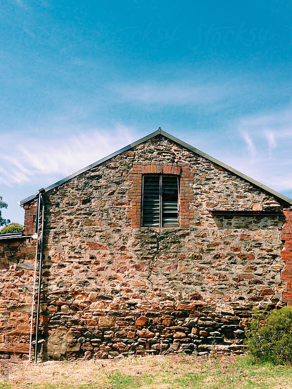 side of an old stone barn by Gillian Vann for Stocksy United