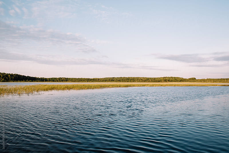 Morning breeze on Minnesota lake by Justin Mullet for Stocksy United