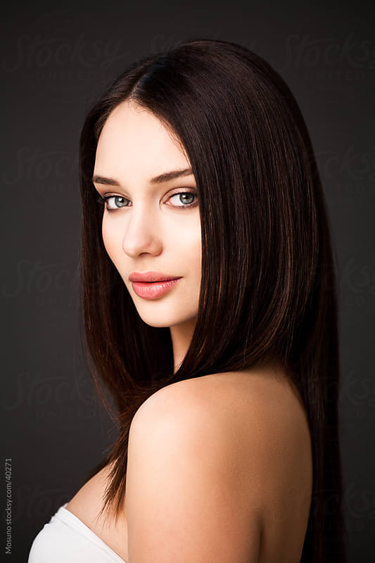 Portrait of a beautiful young brunette. by Mosuno for Stocksy United