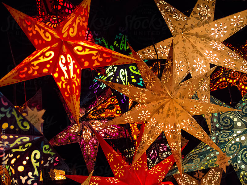 Stars, used as Christmas decoration hanging from a ceiling by Melanie Kintz for Stocksy United