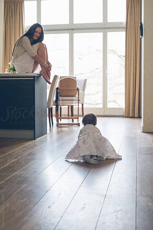 Little girl crawling by Simone Becchetti for Stocksy United