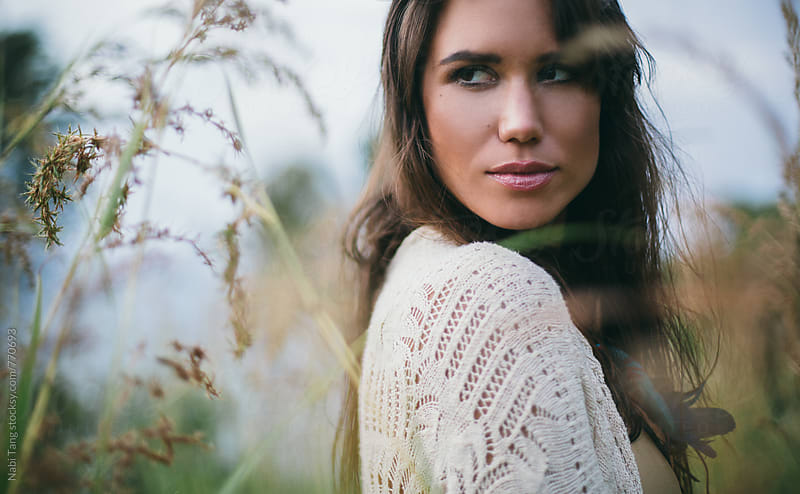 Beautiful woman portrait in the nature by Nabi Tang for Stocksy United
