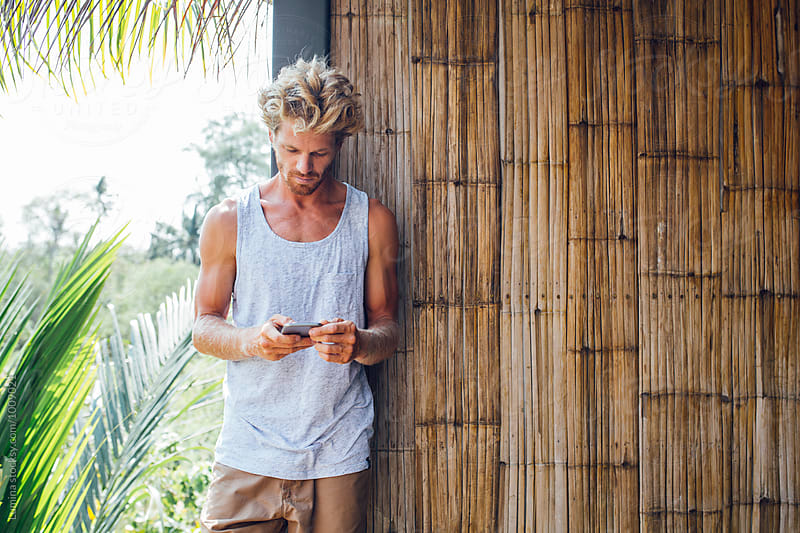 Caucasian Man Using a Mobile Phone by Lumina for Stocksy United
