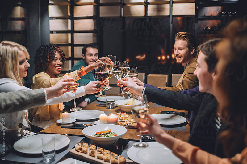 Group of Friends Making a Toast at a Dinner Party by Lumina for Stocksy United
