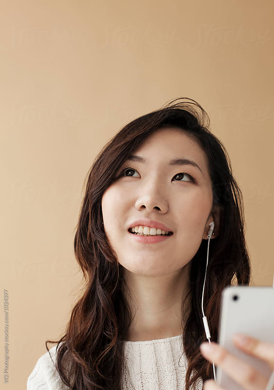 Young woman with smart phone. by W2 Photography for Stocksy United