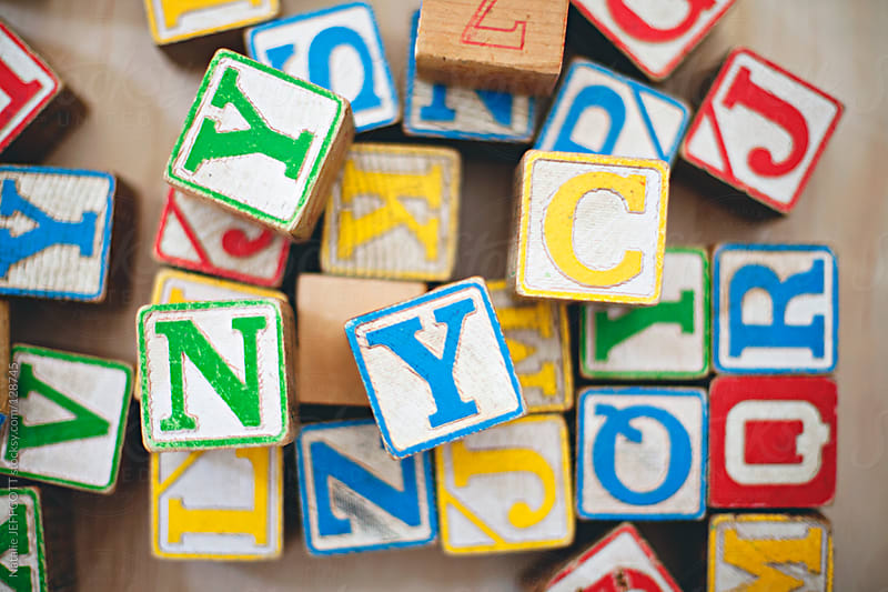 playing with children's wooden blocks NYC by Natalie JEFFCOTT for Stocksy United