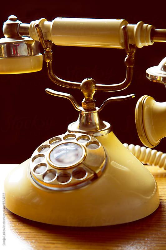 golden retro telephone by Sonja Lekovic for Stocksy United
