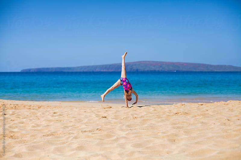 Cartwheel on the beach. by Cherish Bryck for Stocksy United