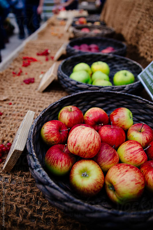 Apples at a market by Andrey Pavlov for Stocksy United