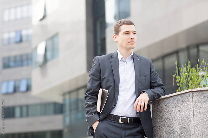 Young businessman standing outdoors. by Mosuno for Stocksy United