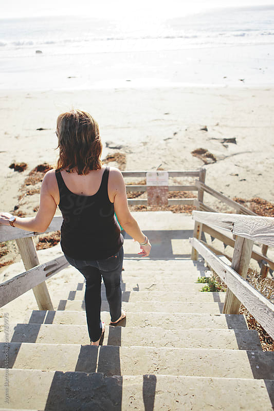 Woman Walks Down Stairs to Beach by Jayme Burrows for Stocksy United