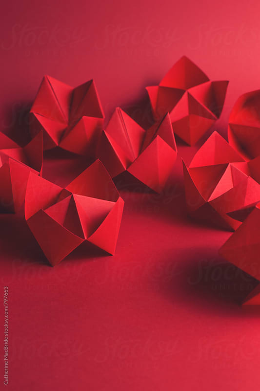 Red fortune tellers on red... by Catherine MacBride for Stocksy United