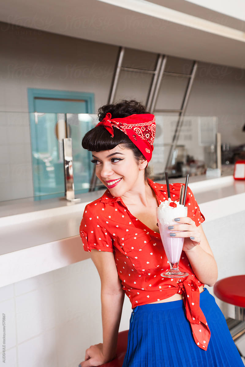 Handsome Female In Stylish Retro Outfit With Milkshake At Diner Restaurant By Audrey Shtecinjo Stocksy United