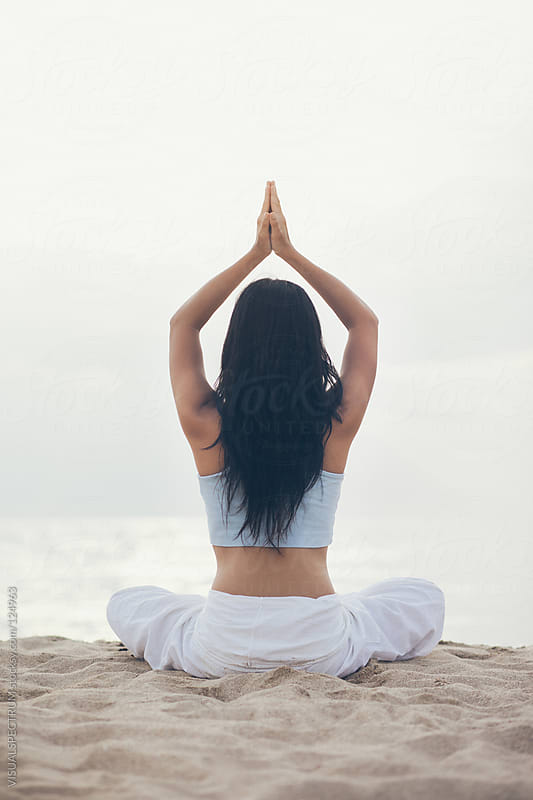Woman Meditating on Beach by VISUALSPECTRUM for Stocksy United