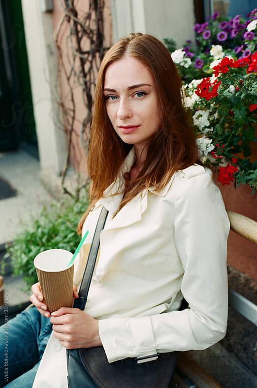 Portrait of a woman with cup of milkshake  by Lyuba Burakova for Stocksy United