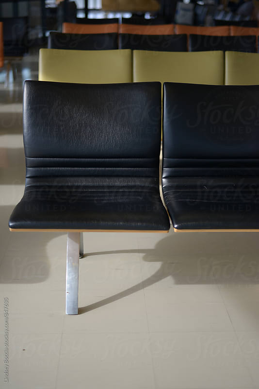 airport chair by Lindsey Boccia for Stocksy United