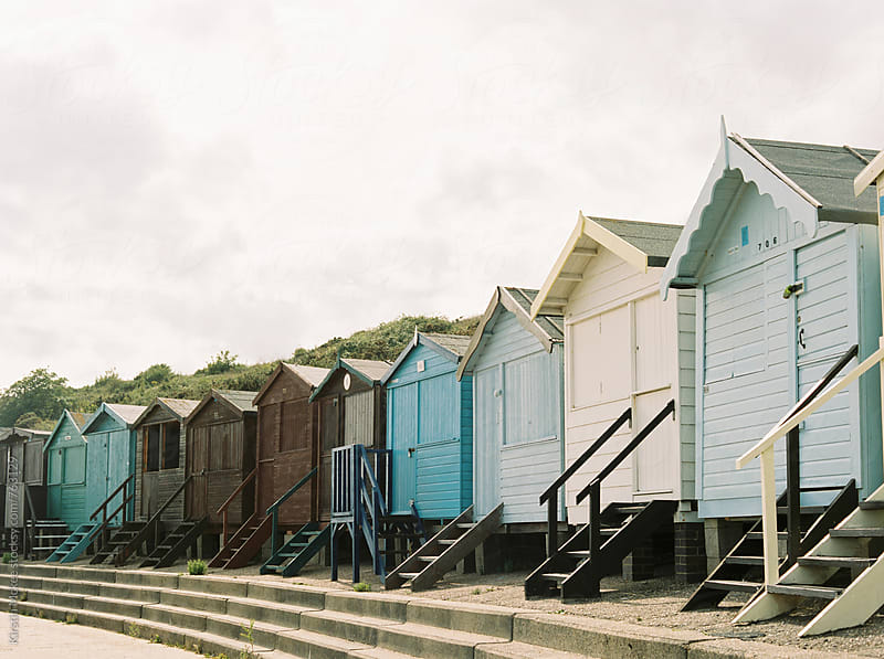 Beach huts in a row at Frinton, Essex by Kirstin Mckee for Stocksy United