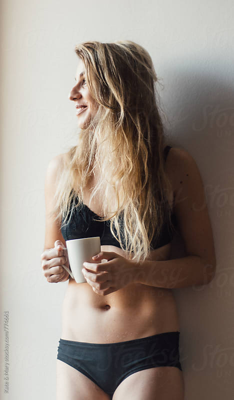Woman in lingerie drinking coffee by Kate & Mary for Stocksy United