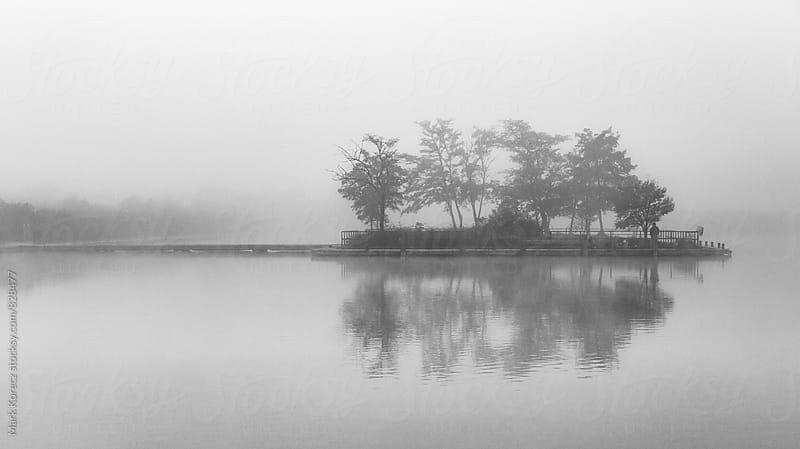 Island in the fog by Mark Korecz for Stocksy United