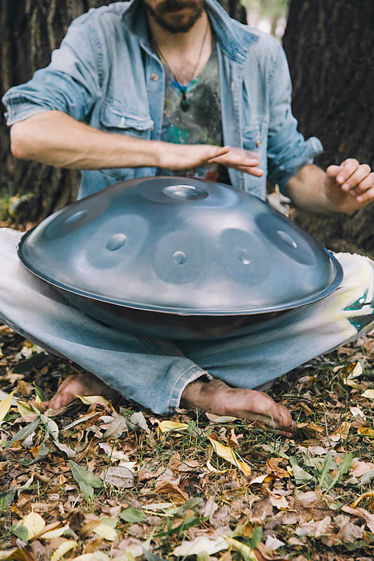 Unrecognizable handpan player by Danil Nevsky for Stocksy United