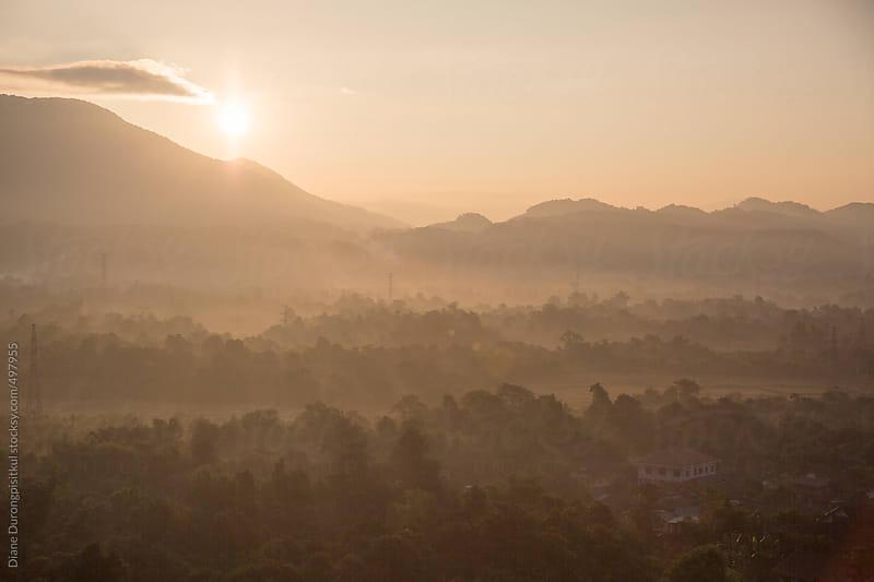 Sunrise over the Landscape by Diane Durongpisitkul for Stocksy United