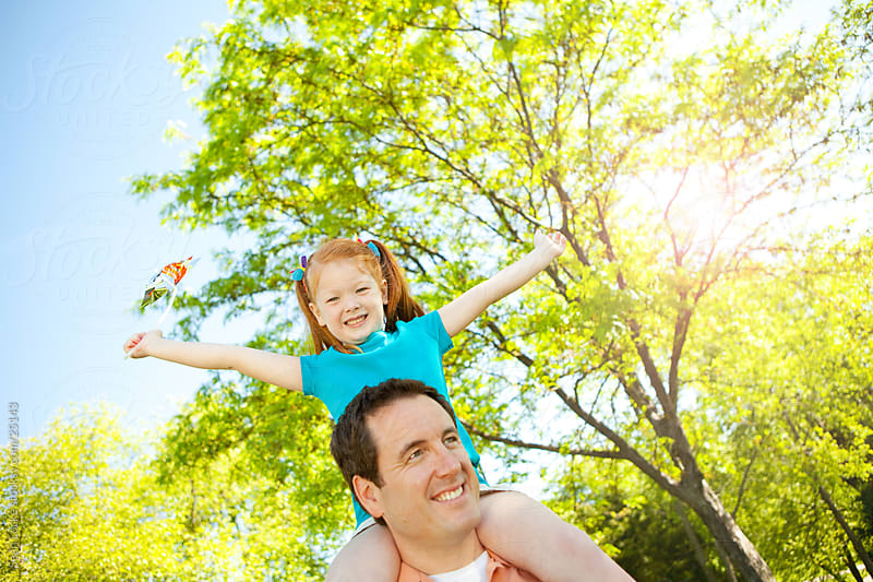Park: Girl Having Great Time with Daddy by Sean Locke for Stocksy United