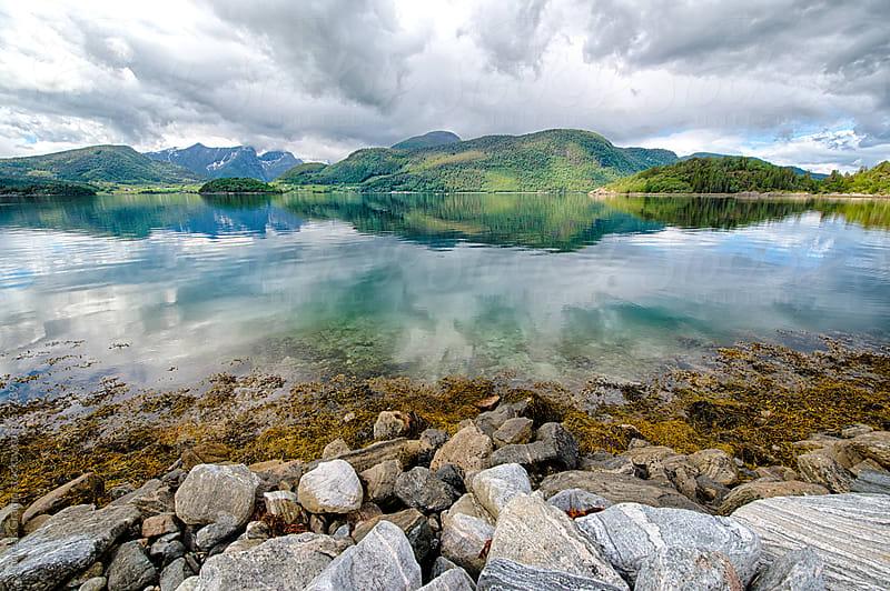 norwegian fjord landscape by Andreas Gradin for Stocksy United