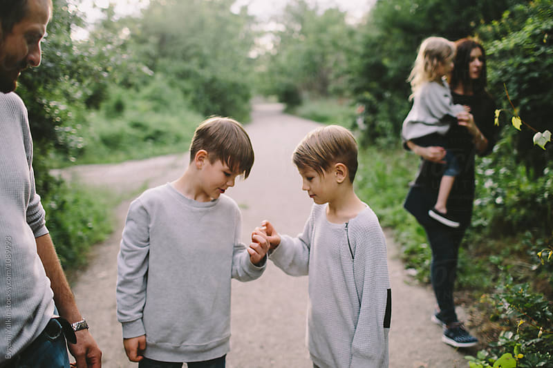 A conversation between two brothers by Evgenij Yulkin for Stocksy United