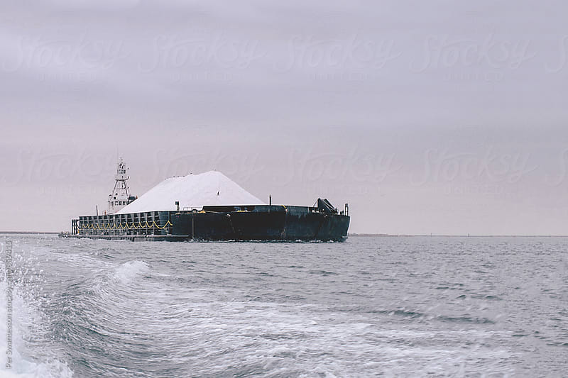 Ship with sea salt harvested from evaporation ponds by Per Swantesson for Stocksy United