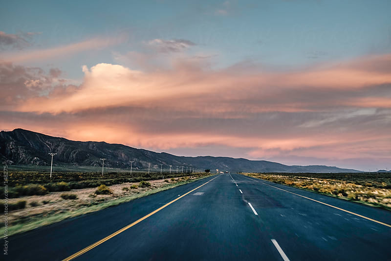 Sunset whilst travelling on an open road by Micky Wiswedel for Stocksy United