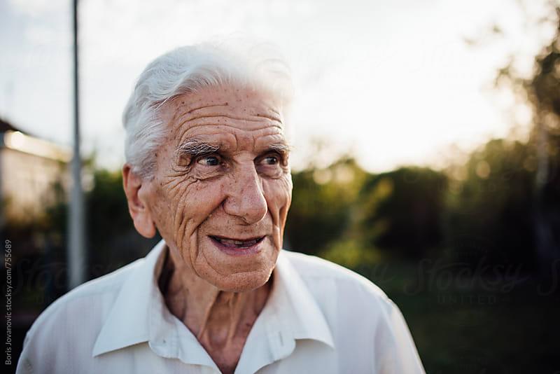 Portrait of senior man by Boris Jovanovic for Stocksy United