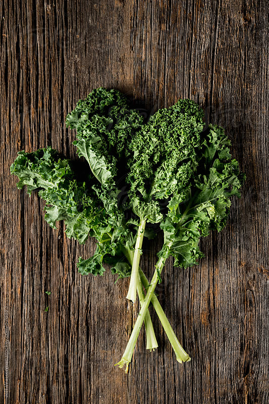 Raw Kale on Wood by Studio Six for Stocksy United