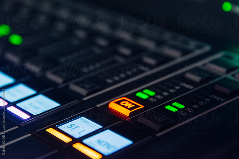 Buttons and LED lights on a audio mixer board by Gabriel (Gabi) Bucataru for Stocksy United