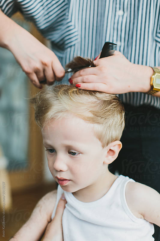 Handsome little blond boy with his new haircut by Amir Kaljikovic for Stocksy United