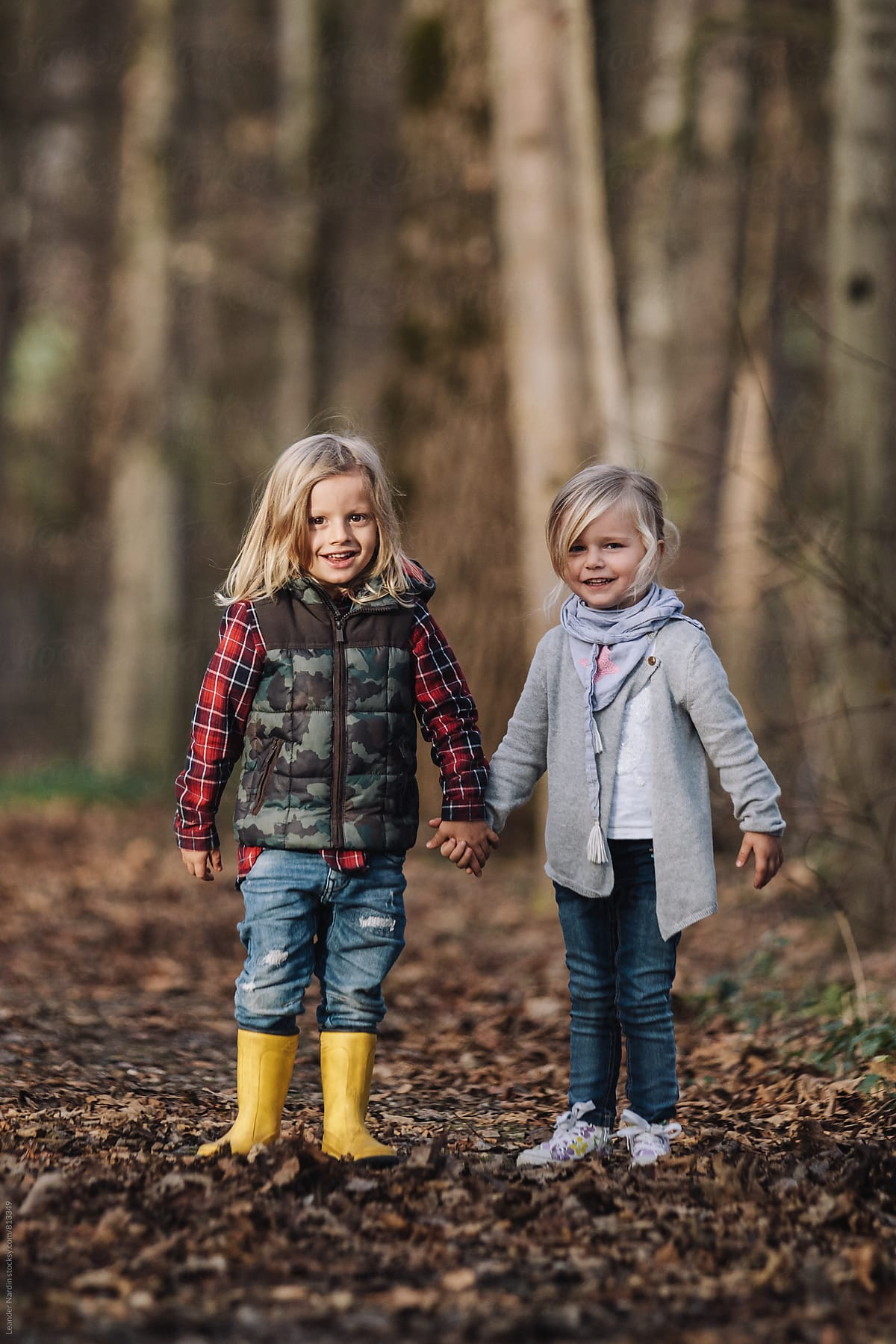 Portrait Of Little Boy And Girl Holding Hands In The Forest First