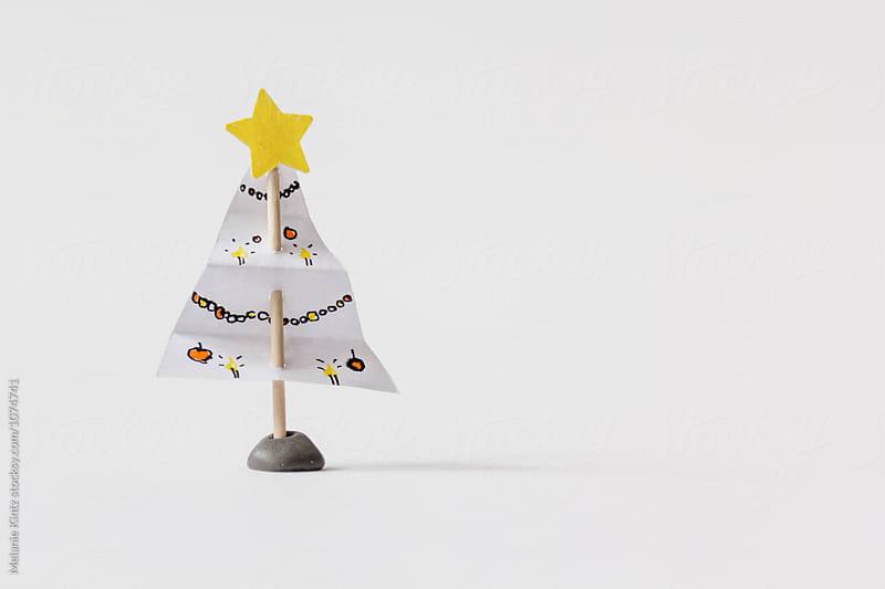 Small, handmade christmas tree on a toothpick by Melanie Kintz for Stocksy United
