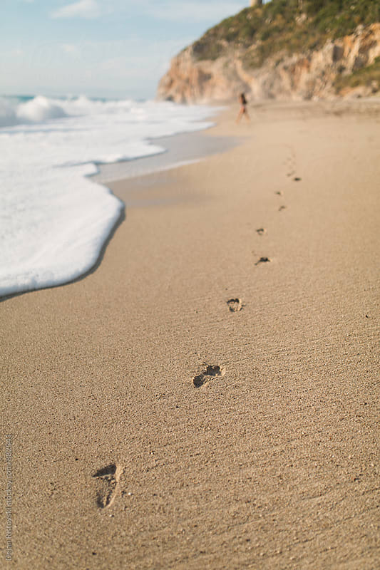 Footprints in the sand. by Dejan Ristovski for Stocksy United