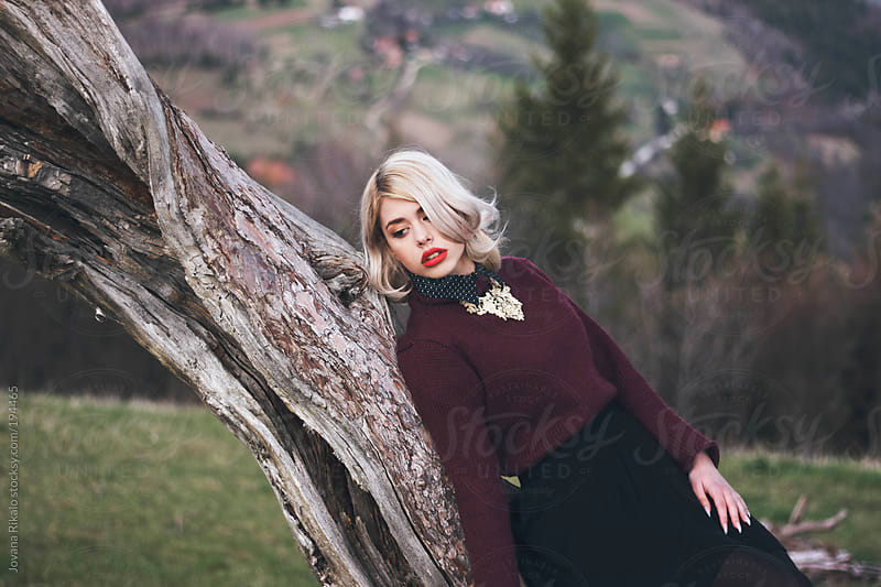 Young woman outdoors by Jovana Rikalo for Stocksy United