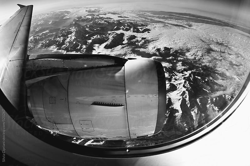 Amazing view through airplane window onto jet engine. by Silvia Cipriani for Stocksy United